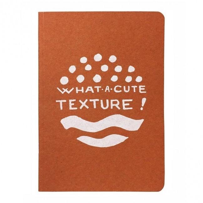 """Notes tascabile """"What a cute texture!"""", copertina arancione e interno in carta colore nero"""