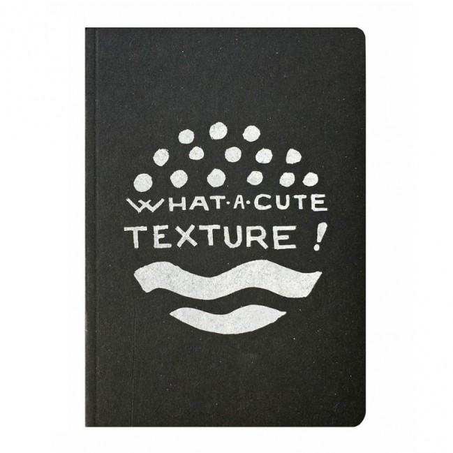 """Notes tascabile """"What a cute texture!"""", copertina nera e interno in carta colore nero"""